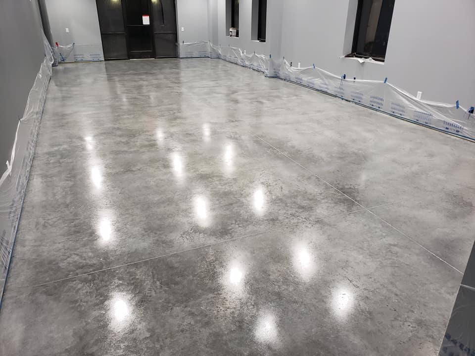 Get a smooth, durable concrete floor for your garage, workshop, or other type of building from Aesthetic Concrete Designs.