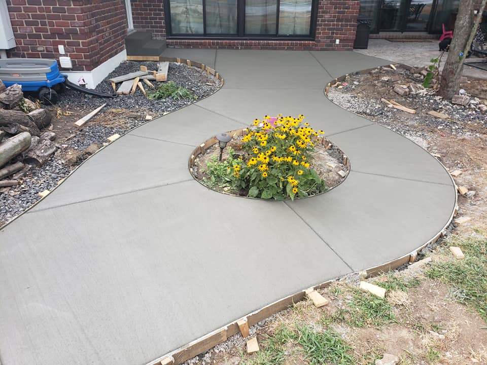 A decorative concrete walkway from Aesthetic Concrete Designs in front of your house can really improve curb appeal.