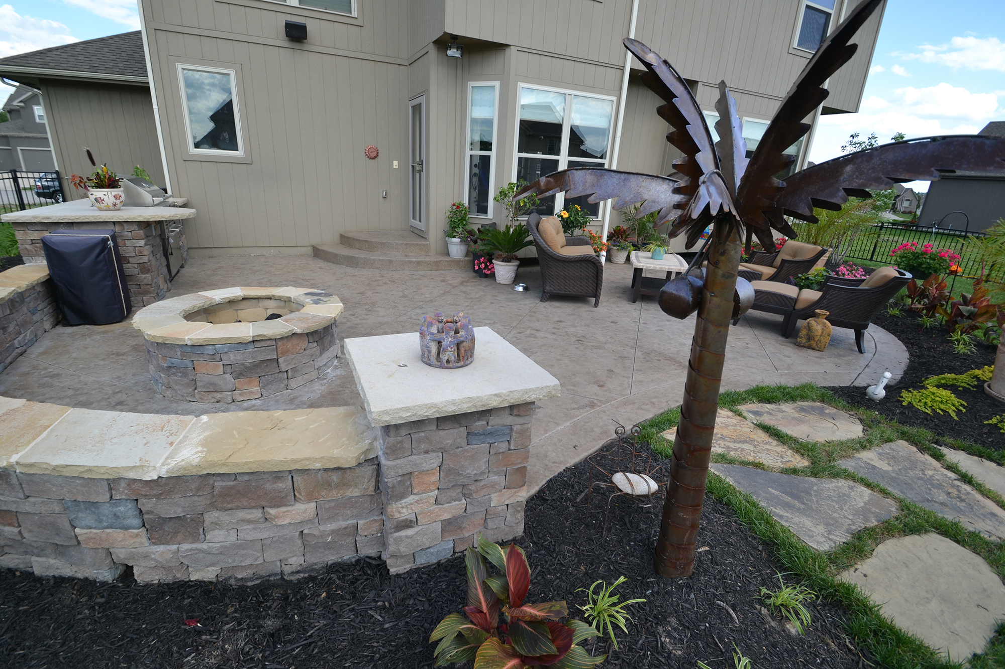 Aesthetic Concrete Designs can make a custom concrete outdoor living area with stamped concrete, concrete walls, and more.