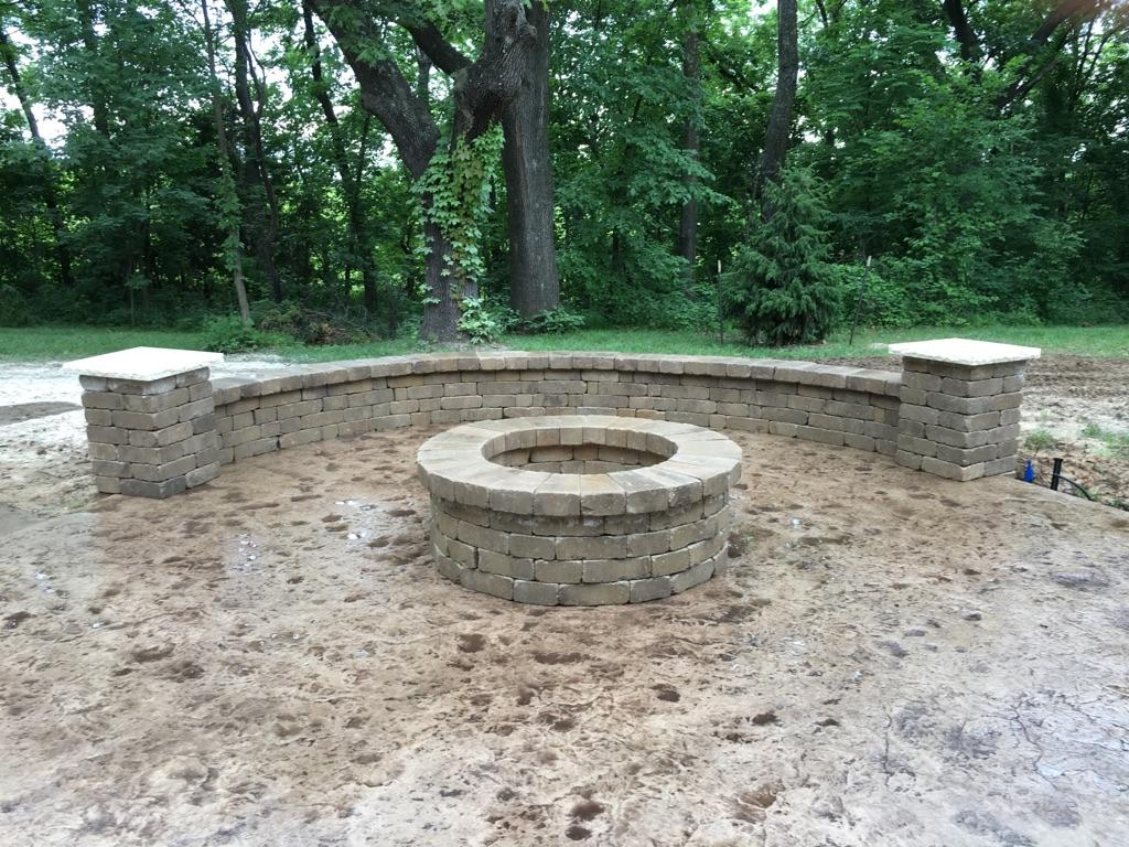 Concrete fire pits and sitting walls are custom designed and built by Aesthetic Concrete Designs.