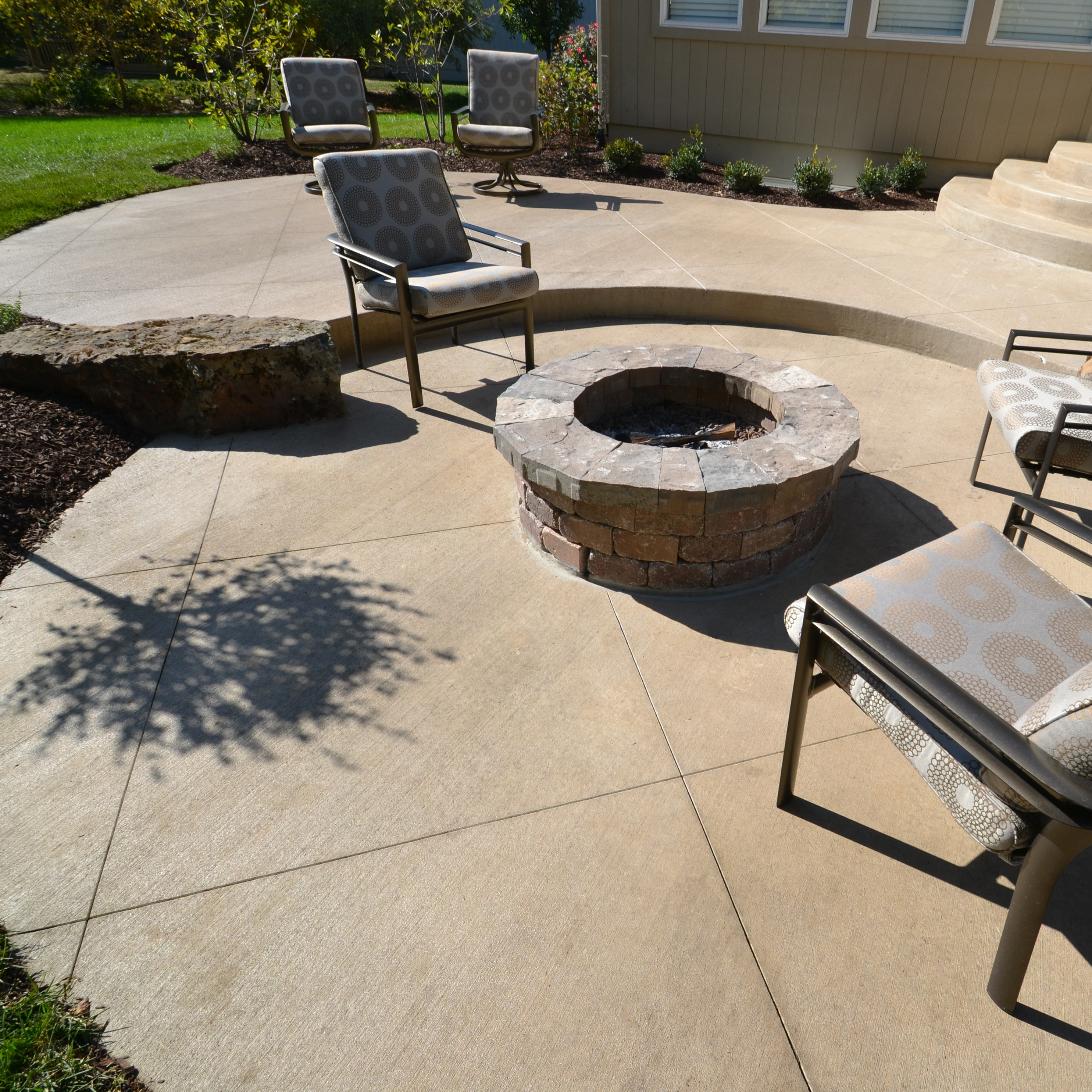 A custom concrete patio and fire pit by Aesthetic Concrete Designs that you can have in your backyard.