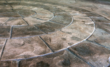 Stamped concrete used to make custom shapes and designs by Aesthetic Concrete Designs.