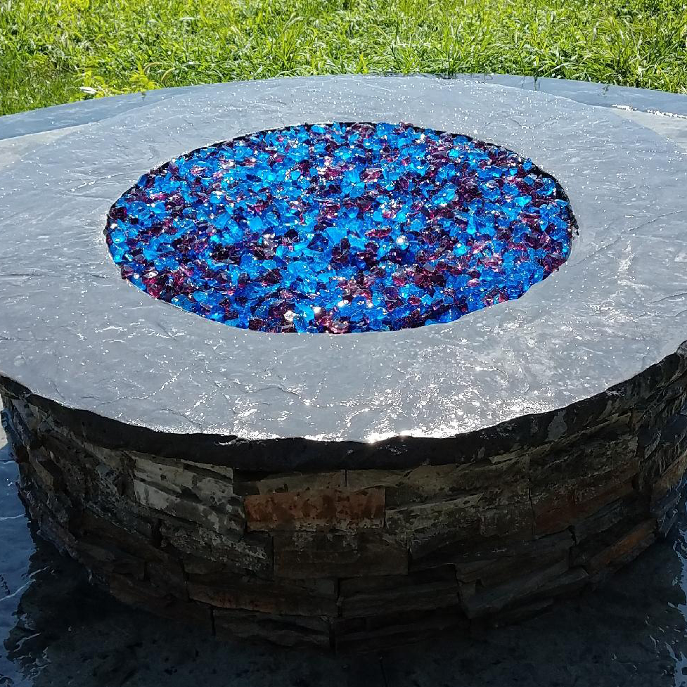 A custom round concrete firepit can be built for your backyard by Aesthetic Concrete Designs.